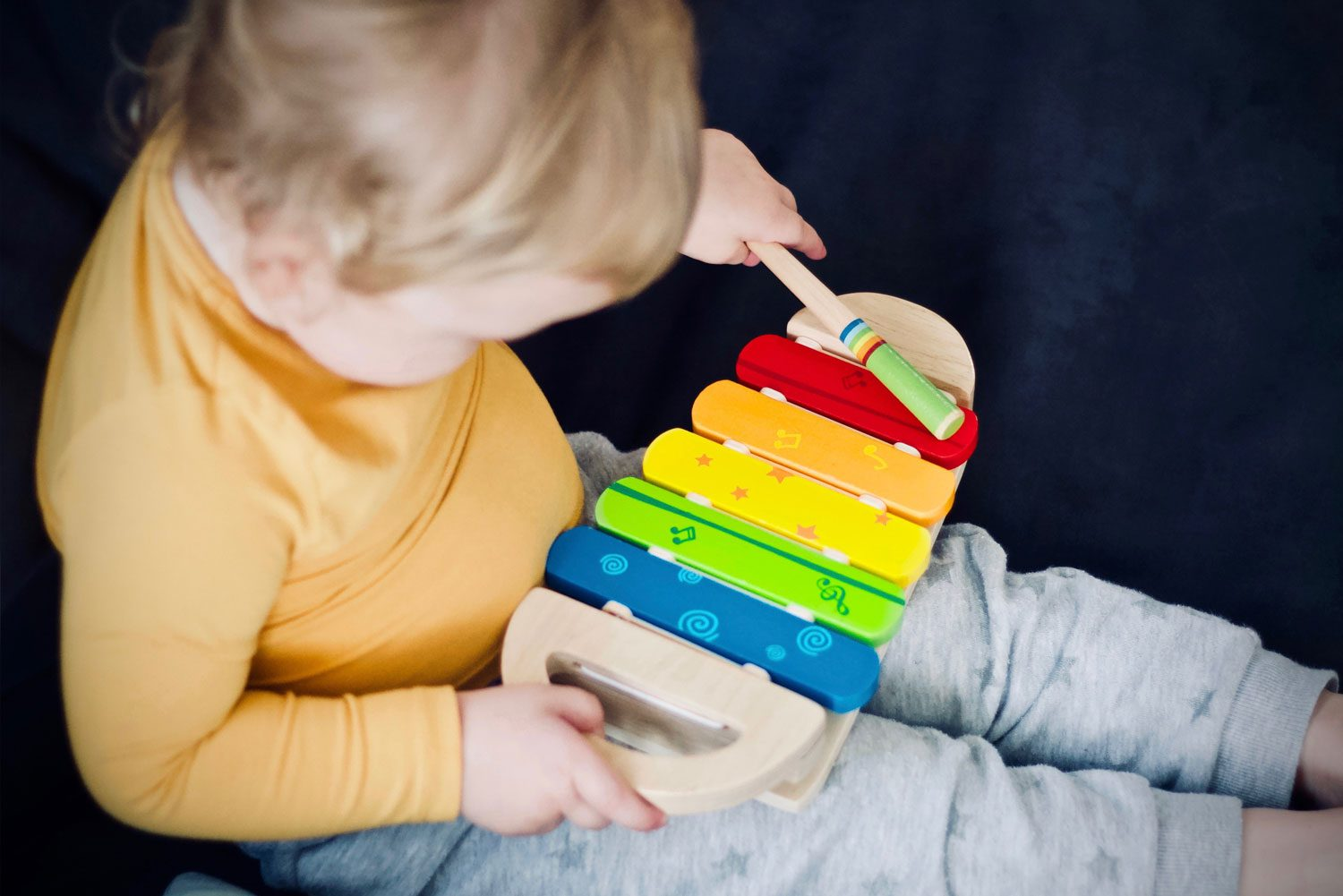 child playing on xylophone
