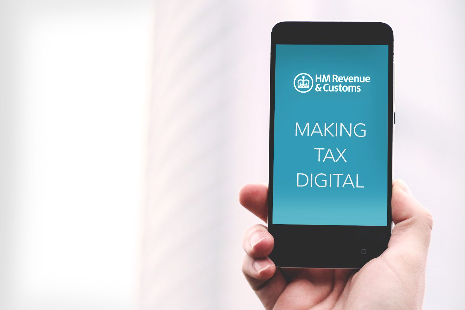 mobile phone showing making tax digital words