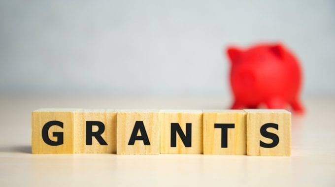 Wooden Blocks Spelling Out The Word Grants