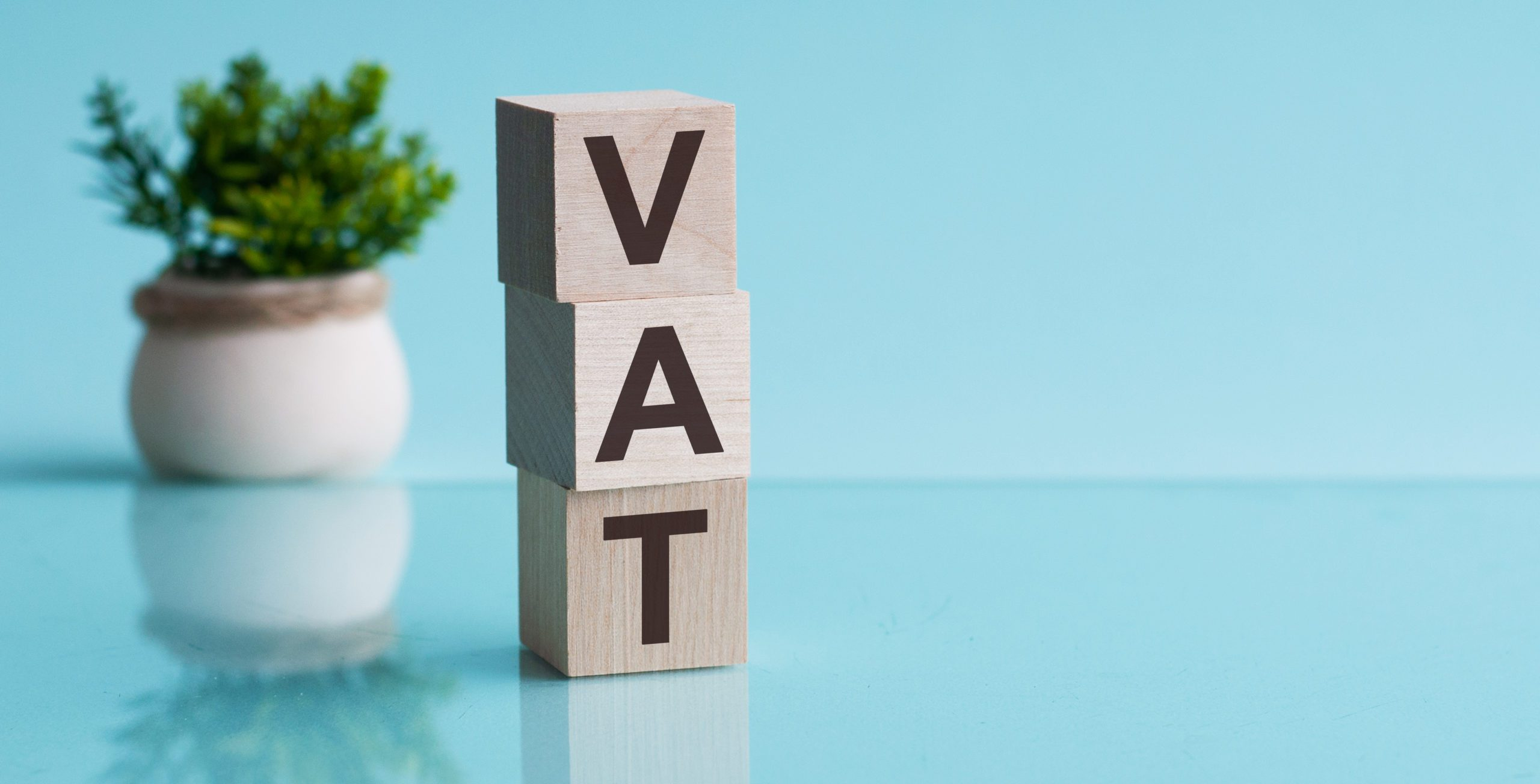 VAT deferral scheme indicated on wooden blocks reading VAT
