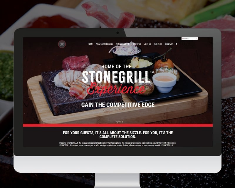 Picture of the Stonegrill USA website showing food cooking on a stone grill